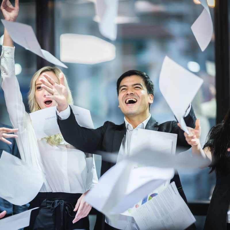 A group of business people are happy for success Celebrating business success